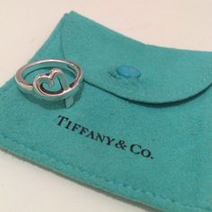 Tiffany & co. Paloma Picasso Loving Heart Ring This ring is a classic and still sold in Tiffany boutiques! Sterling silver. Normal wear and tear, but hardly noticable. Ring size 7. I wore this on my middle or pointer finger. Will include original pouch. Pouch has some wear by snap. Tiffany & Co. Jewelry Rings