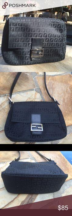 Fendi  Vintage black logo purse handbag💜 Fendi black logo purse flap magnetic closure- interior one zipper pocket- good condition. Exterior some wear on the bottom back corners- Classic fendi silver emblem otherwise great condition. Fendi Bags