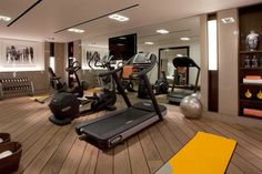 If making a gym in the basement, which is a great idea, a mirrored wall opens up the space and love how they added some art to the left and...