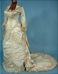 1882 Wedding Bustle Gown of Ivory Satin with Pearls and Silk Confetti Fringe! Long Train Antique Dress - Item for Sale Antique Wedding Dresses, Vintage Gowns, Vintage Bridal, Vintage Outfits, Ivory Wedding, Wedding Gowns, Edwardian Fashion, Vintage Fashion, Steampunk Fashion