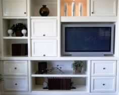 Interior design tips for creating a beautiful room without your flat panel TV dominating your design. Ideas to hide your flat screen TV - we help you get creative!