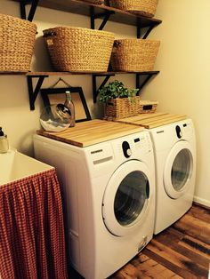 SMALL LAUNDRY ROOM. Decor to hide drain and plugs behind washer and dryer. Laundry baskets from Pier One, shelf brackets from Ikea, cutting boards from Kobi Blocks, flooring from Longwood Antique Woods, and decor from Homegoods.