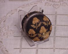 """The Quaker pincushion, these pinballs were actually knitted using silk on very tiny knitting needles. Our needlewoman gave us her initials - """"M. Embroidery Tools, Blackwork Embroidery, Vintage Sewing Box, Vintage Pins, Needle Case, Needle Book, Sewing Baskets, Sewing Tools, Places"""