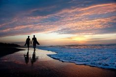 Engagement Shoot. Beach Walk. A beach Engagement shoot with vibrant sky