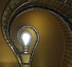 Staircase spiraling up, looking like a light bulb abstract.