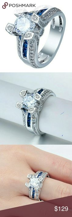 Beautiful 2ct round cubic blue sapphires Beautiful 2ct cubic zirconia creating a bridge over stunning square cut blue sapphires.  Ring is in 925 sterling silver. Jewelry Rings