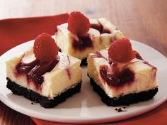 Delight your guests with these beautiful raspberry cheesecake bars made using chocolate wafer cookies - a perfect baked dessert.