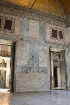 Marble revetment in Hagia Sophia - you can see the two panels of porphyry with opus sectile borders above the door on the right