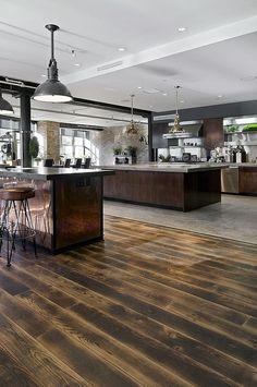 Expansive industrial kitchen in the loft home [Design: Siberian Floors] - Decoist