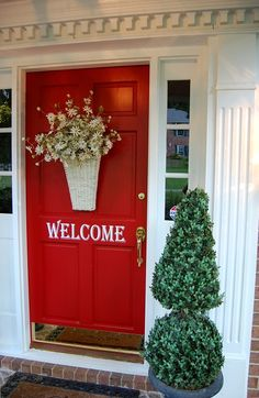 What a welcoming front door & a cool color of red too ...love it!