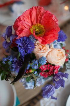 Colorful red and purple floral centerpiece | Carmen and Ingo Photography | see more on: http://burnettsboards.com/2014/03/colorful-bohemian-wedding/