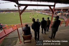 Workington AFC 0 Boston United 1, 24/02/2008. Borough Park, Blue Square North. Fans in the covered terracing watching the action during the Blue Square North fixture between hosts Workington AFC (red) and Boston United at Borough Park. The visitors won with a solitary sixth-minute goal by Jon Rowan in front of 388 spectators. Both Workington AFC and Boston United were members of the Football League, the Cumbrians losing League status in 1977 while the Lincolnshire club were relegated in 2007… Bill Shankly, Blue Square, The Visitors, Liverpool Fc, Rowan, All About Time, Boston, Fans, Action