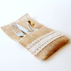 Make your own burlap utensil holders. Enough room to add seasonal or event cloth napkins. Visit for tutorial.