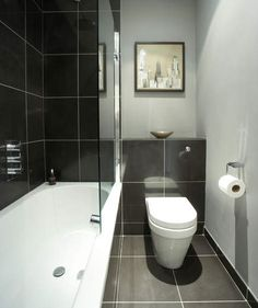 Small monochrome bathroom - Go for a black, white and grey colour scheme to get that hotel-chic look in a small bathroom. Here, black bathroom tiles add definition to the soft grey walls, and a glass shower screen gives the illusion of more space - ideal Small Grey Bathrooms, Grey Bathrooms Designs, Bathroom Design Small, Bathroom Layout, Narrow Bathroom, Bathrooms 2017, Compact Bathroom, Bathroom Colours, Cottage Bathrooms