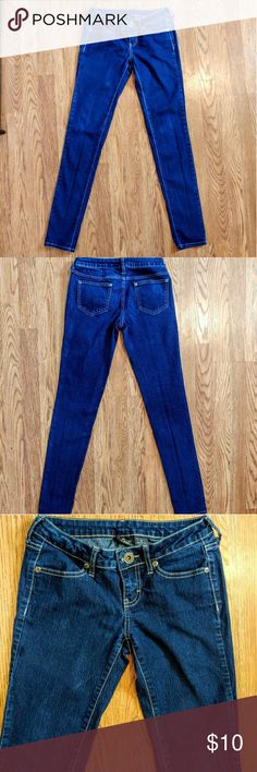 City Streets Skinny Jeans Fitted Dark/Medium wash straight leg jeans.  Lightly worn and closest to the color in the last photo. City Streets Jeans Straight Leg