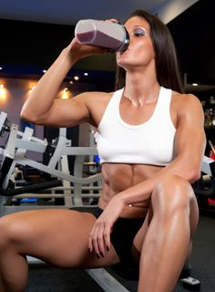 Athletic woman resting on weight bench