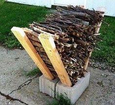 Easy firewood storage. 2 cinder blocks/4  2x 4 lengths