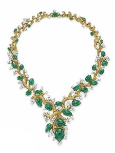 AN EMERALD, DIAMOND AND GOLD NECKLACE. This necklace is designed as a sculpted gold branch, extending pear-shaped cabochon emerald leaves with circular and pear-shaped diamond buds. Christie's.