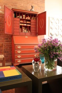 Painted secretaire bookcase at Wendy Kidd's NYC apartment/hair studio designed by Jim Fairfax.