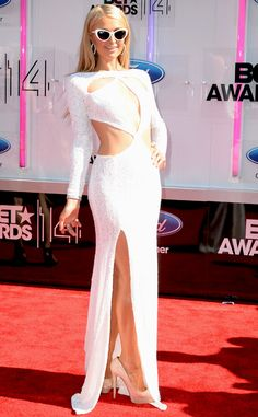 Paris Hilton wows in a sultry white gown with geometric cutouts.