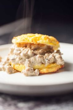 A super easy low carb cheddar biscuit piled high with gluten free sausage gravy...makes a delicious low carb breakfast or low carb dinner!