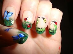 Gorgeous hand painted garden scenery nails, nude nails with caterpillars, flowers, butterflies, ladybugs and bees. Adorable! Free hand nail art