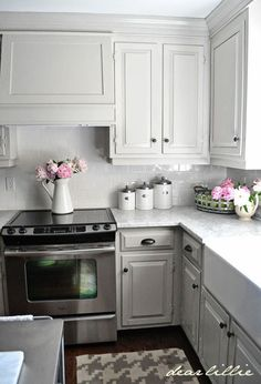 Dear Lillie: Our Kitchen Makeover (Before and Afters and a Full Source List). Love the cabinets and pulls.