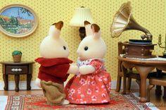Bunnies dancing to the gramophone aww