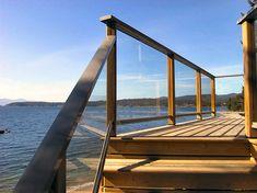 Cedar Deck Railing with Glass See 100s of Deck Railing Ideas http://awoodrailing.com/2014/11/16/100s-of-deck-railing-ideas-designs/