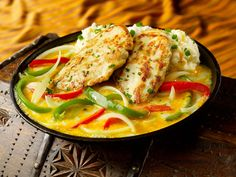 """T.G.I. FRIDAY'S SIZZLING CHICKEN & CHEESE: ~ From: Recipe Secrets.Net ~ Recipe Courtesy of  """"T.G.I. Friday's.Com ~ Yield: (2 Servings). ~  T.G.I. Friday's Sizzling Chicken and Cheese is a delicious skillet of onions and peppers with garlic-marinated chicken breasts and topped with a good portion of cheese.  This tasty dish is something the whole family will love."""