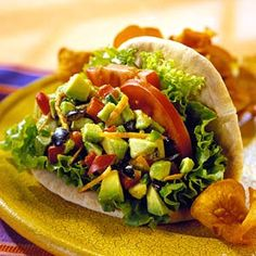 Avocado-Veggie Pita -The spicy filling of avocados, jalapenos, lemon juice, shredded carrots, and olives for this meatless sandwich can be made-ahead and spooned into pita rounds just before serving.