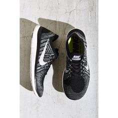 Nike Free 4.0 Flyknit Sneaker (160 CAD) ❤ liked on Polyvore featuring shoes, sneakers, black, nike trainers, nike sneakers, black trainers, nike and black sneakers