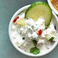 Cucumber Party Dip  Ingredients   1 8 ounce package cream cheese, softened  1 8 ounce carton dairy sour cream  1/2  of a medium cucumber, seeded and chopped  1 small tomato, seeded and chopped  1/4  cup snipped fresh cilantro  Salt  Ground black pepper  Cucumber slices, baby carrots and/or assorted crackers