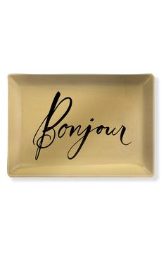 A shimmering golden finish illuminates this delicate glass trinket tray embellished with scripted 'Bonjour' lettering for a touch of Francophile flair.