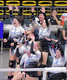 Sky View High School players celebrate a teammate's block at the state volleyball tournament in Orem, Utah. The Bobcats are back in the semifinals after a victory in the second round of the 4A Volleyball Tournament. (Photo by Eli Lucero)