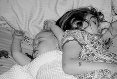 Family bed transitioning from one child to two cosleeping second child
