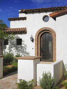 Spanish Mission House Wrought Iron Low Pitched Roof