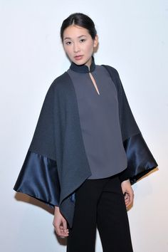 Model Nazik Sokolovsky poses backstage at the Blanc de Chine Fall 2012 fashion show during Mercedes-Benz Fashion Week on February 2012 in New York City. Abaya Fashion, Fashion Wear, Fashion Show, Fashion Looks, Oriental Fashion, Asian Fashion, Qipao Modern, Chinese Gown, Iranian Women Fashion
