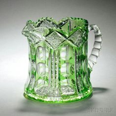 Green Cut-to-Clear Glass Pitcher, late 19th/early 20th century, squat with flared foot, with notched and scalloped rim, hobstars set within diamonds above bands with three thumbprints, with hobstar to underside, and applied handle, unmarked, ht. 6 3/4 in.