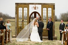*Swoon!  This vintage door wedding altar stopped my heart.  How incredible is this?  The doors- the chandelier- it's all so picture perfect!  vintage doors, wedding ideas, outdoor wedding, vintage wedding, repurposed doors, wedding altar ideas, recycled design