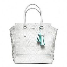 Coach - LEGACY CONTRAST EDGE PYTHON NORTH/SOUTH TANNER TOTE  This bag is a must have for the hottest season of the year!