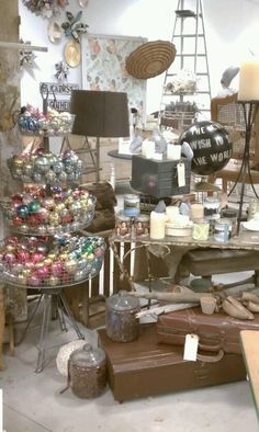 love the shiny brights in that tiered basket.  Paint a bad globe.