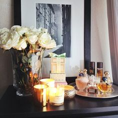 Dresser decor - love the florals, candle assortment, and tray with perfumes (could add lotions). GREAT functional use of dresser-top space for the night stand OR long dresser Perfume Display, Perfume Tray, Perfume Bottles, Estilo Interior, Decoration For Ganpati, Décor Boho, Home And Deco, My New Room, Apartment Living