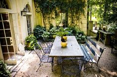the patio I want...rectangular table with bench and chairs, pea gravel