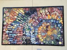 Mosaic mural with ceramic tiles made by elementary art students.