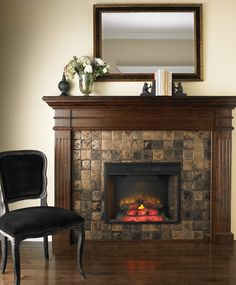 There's no substitute for a solid wood mantel with elegant moulding for a radiant style. Brilliant bronze metal tiles, decorative corner accents and a surround finished in French walnut gives this fireplace a classic look. #Fireplace #Decor #IndoorSpaces