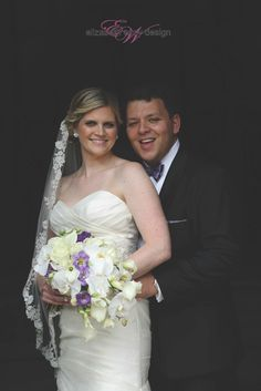 Classy Couple = Classic Bouquet with White Roses, White Calla Lilies, White Moth Orchids and a splash of Purple Lisianthus