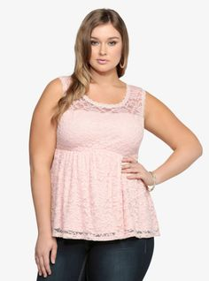 We love lace - it's chic, sexy and totally timeless. This peachy pink empire top is made from allover stretch lace with a lined bodice leaving the upper chest and shoulders to reveal a flirty see-through look. A scalloped lace trim and plunging back V-neck add allure to the darling top.