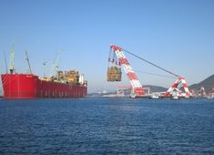 """Hubris Knows No Bounds (haiku) """"Floating liquified - natural gas plus typhoon - equals disaster"""" Prelude and crane"""