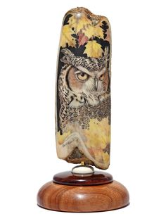 """Fall Foliage Owl"" Color scrimshaw on ancient walrus tusk ivory artifact by David Adams. Just when one thinks that Adams cannot do a better wildlife scrimshaw, he comes up with something like this gem. Simply outstanding work by one of the very best working today. The ivory is unusual in that it was probably used as a sled runner by ancient people in the Bering Sea area hundreds of years ago. Size: 2 3/4"" Diameter x 6 1/4""H Price: $1,750.00 -- on ScrimshawGallery.com #scrimshaw"